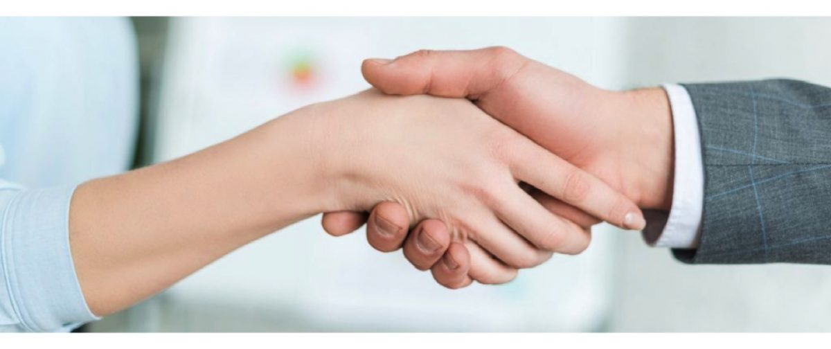 A home owner shaking hands with a roof repair contractor to start Roof repair services to fix his roof problems